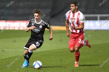 Crawley Town defender Nick Tsaroulla (25) runs the ball chased by Stevenage defender Luther James-Wildin (2) during the EFL Sky Bet League 2 match between Stevenage and Crawley Town at the Lamex Stadium, Stevenage