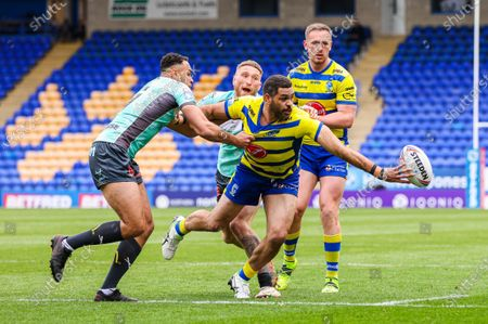 Warrington's Greg Inglis is tackled by Hull KR's Luis Johnson and Ethan Ryan.
