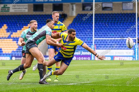 Stock Picture of Warrington's Greg Inglis is tackled by Hull KR's Luis Johnson and Ethan Ryan.