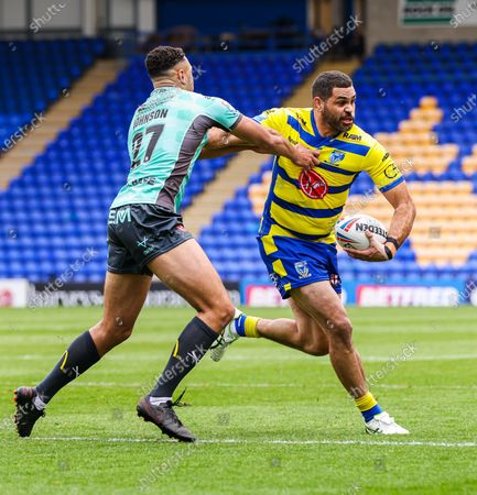 Warrington's Greg Inglis is tackled by Hull KR's Luis Johnson.