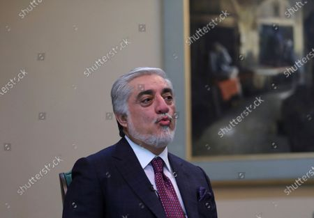 Abdullah Abdullah, Chairman of the High Council for National Reconciliation gives an interview to The Associated Press at the Sapidar Palace in Kabul, Afghanistan, . Afghanistan's chief peace negotiator says the often fractured Afghan political leadership must unify or risk the withdrawal of U.S. and NATO troops that has officially begun bringing more bitter fighting