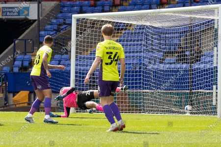 Goal 1-0 Exeter City goalkeeper Jökull Andresson (24)concedes a goal from Bolton Wanderers defender Gethin Jones (2) during the EFL Sky Bet League 2 match between Bolton Wanderers and Exeter City at the University of  Bolton Stadium, Bolton