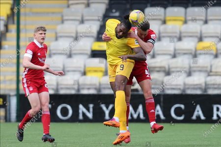 Aberdeen's Andrew Considine (4) and Jay Emmanuel-Thomas (9) of Livingston battles for possession, tussles, tackles, challenges, during the Scottish Premiership match between Livingston and Aberdeen at Tony Macaroni Arena, Livingstone
