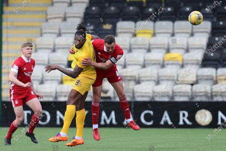 Aberdeen's Andrew Considine (4) and Jay Emmanuel-Thomas (9) of Livingston heads the ball, aeriel challenge during the Scottish Premiership match between Livingston and Aberdeen at Tony Macaroni Arena, Livingstone