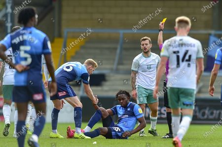 AFC Bournemouth's Jack Wilshere (11) gets a yellow card for foul on Wycombe Wanderers Admiral Muskwe (15) during the EFL Sky Bet Championship match between Wycombe Wanderers and Bournemouth at Adams Park, High Wycombe