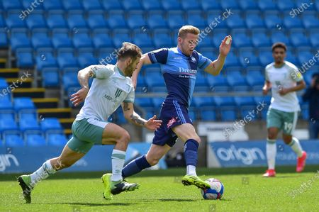 Wycombe Wanderers Jason McCarthy (26) runs with the ball challenged by AFC Bournemouth's Jack Wilshere (11) during the EFL Sky Bet Championship match between Wycombe Wanderers and Bournemouth at Adams Park, High Wycombe