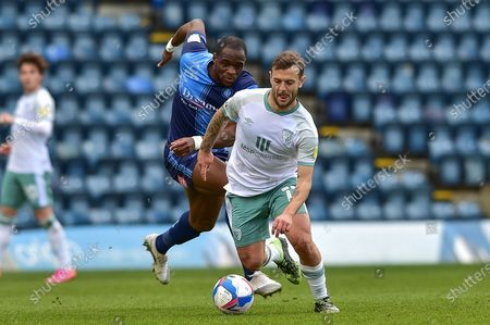 AFC Bournemouth's Jack Wilshere (11) is chased by Wycombe Wanderers Uche Ikpeazu (9) during the EFL Sky Bet Championship match between Wycombe Wanderers and Bournemouth at Adams Park, High Wycombe