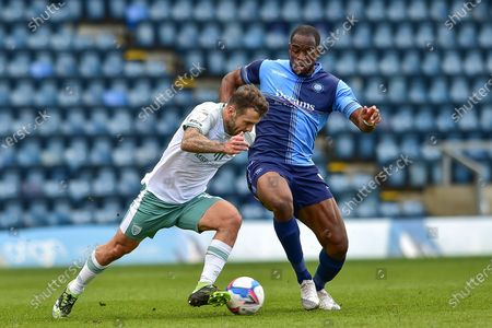 AFC Bournemouth's Jack Wilshere (11) gets away from Wycombe Wanderers Uche Ikpeazu (9) during the EFL Sky Bet Championship match between Wycombe Wanderers and Bournemouth at Adams Park, High Wycombe
