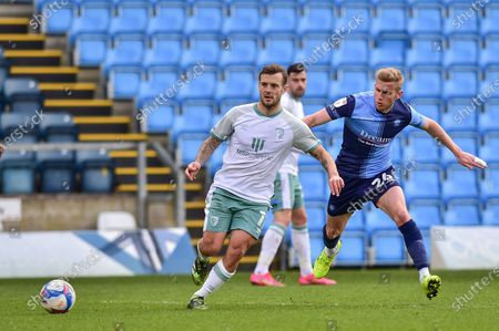 AFC Bournemouth's Jack Wilshere (11) plays a pass challenged by Wycombe Wanderers Jason McCarthy (26) during the EFL Sky Bet Championship match between Wycombe Wanderers and Bournemouth at Adams Park, High Wycombe