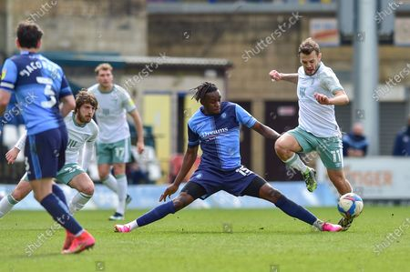 Wycombe Wanderers Admiral Muskwe (15) and AFC Bournemouth's Jack Wilshere (11) battle for possession during the EFL Sky Bet Championship match between Wycombe Wanderers and Bournemouth at Adams Park, High Wycombe