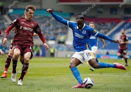 Brighton's Danny Welbeck kicks the ball during the English Premier League soccer match between Brighton and Hove Albion and Leeds United at the Falmer stadium in Brighton, England