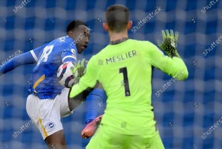 Leeds United's goalkeeper Illan Meslier makes a save in front of Brighton's Danny Welbeck during the English Premier League soccer match between Brighton and Hove Albion and Leeds United at the Falmer stadium in Brighton, England