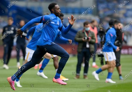 Brighton's Danny Welbeck runs during warm up before the English Premier League soccer match between Brighton and Hove Albion and Leeds United at the Falmer stadium in Brighton, England