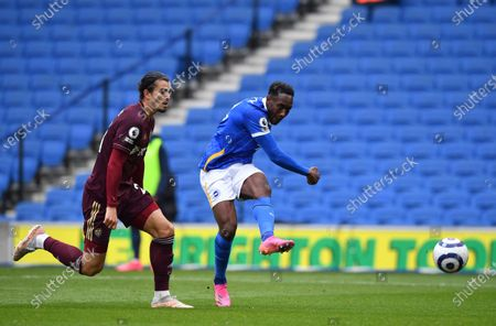 Brighton's Danny Welbeck, right, scores his side's second goal during the English Premier League soccer match between Brighton and Hove Albion and Leeds United at the Falmer stadium in Brighton, England