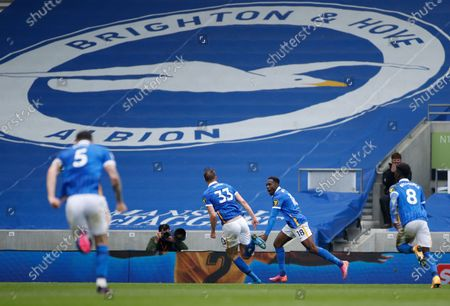 Brighton's Danny Welbeck, second right, celebrates after scoring his side's second goal during the English Premier League soccer match between Brighton and Hove Albion and Leeds United at the Falmer stadium in Brighton, England