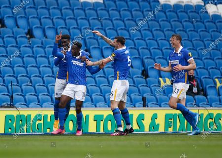 Brighton's Danny Welbeck celebrates with teammates after scoring his side's second goal during the English Premier League soccer match between Brighton and Hove Albion and Leeds United at the Falmer stadium in Brighton, England