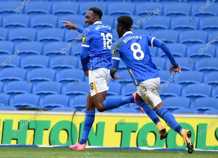 Brighton's Danny Welbeck, left, celebrates after scoring his side's second goal during the English Premier League soccer match between Brighton and Hove Albion and Leeds United at the Falmer stadium in Brighton, England