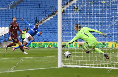 Brighton's Danny Welbeck, center, scores his side's second goal during the English Premier League soccer match between Brighton and Hove Albion and Leeds United at the Falmer stadium in Brighton, England
