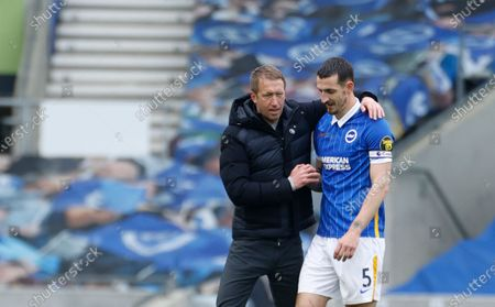 Stock Picture of Brighton's head coach Graham Potter, left, celebrates with Brighton's Lewis Dunk at the end of the English Premier League soccer match between Brighton and Hove Albion and Leeds United at the Falmer stadium in Brighton, England