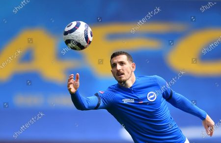 Stock Photo of Brighton's Lewis Dunk during warm up before the English Premier League soccer match between Brighton and Hove Albion and Leeds United at the Falmer stadium in Brighton, England