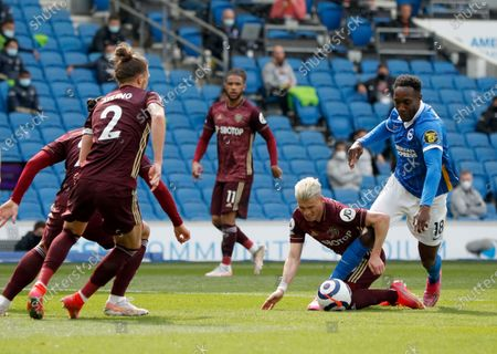 Brighton's Danny Welbeck, right, duels for the ball with Leeds United's Ezgjan Alioski during the English Premier League soccer match between Brighton and Hove Albion and Leeds United at the Falmer stadium in Brighton, England