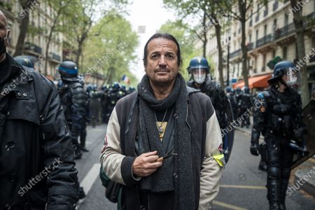 French singer and Gilets Jaunes (Yellow Vests) movement supporter Francis Lalanne (C) attends the annual May Day march in Paris, France, 01 May 2021. Labour Day, also known as International Workers' Day or May Day, is observed worldwide on 01 May.
