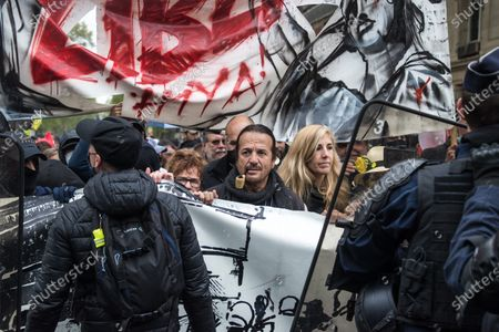 French singer and Gilets Jaunes movement supporter Francis Lalanne (C) attends the annual May Day march in Paris, France, 01 May 2021. Labour Day, also known as International Workers' Day or May Day, is observed worldwide on 01 May.