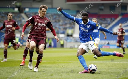 Stock Picture of Danny Welbeck (R) of Brighton in action against Diego Llorente of Leeds during the English Premier League soccer match between Brighton Hove Albion and Leeds United in Brighton, Britain, 01 May 2021.