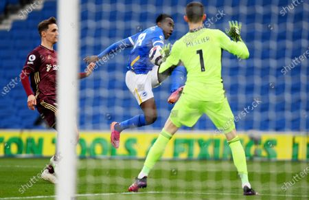 Stock Photo of Danny Welbeck (C) of Brighton tries to score against Leeds goalkeeper Illan Meslier during the English Premier League soccer match between Brighton Hove Albion and Leeds United in Brighton, Britain, 01 May 2021.