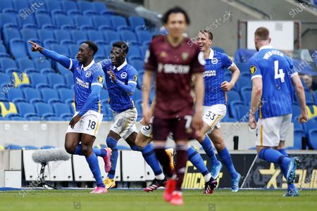 Danny Welbeck (L) of Brighton celebrates with teammates after scoring the 2-0 against Leeds goalkeeper Illan Meslier during the English Premier League soccer match between Brighton Hove Albion and Leeds United in Brighton, Britain, 01 May 2021.