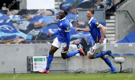 Danny Welbeck (L) of Brighton celebrates with teammate Dan Burn after scoring the 2-0 against Leeds goalkeeper Illan Meslier during the English Premier League soccer match between Brighton Hove Albion and Leeds United in Brighton, Britain, 01 May 2021.