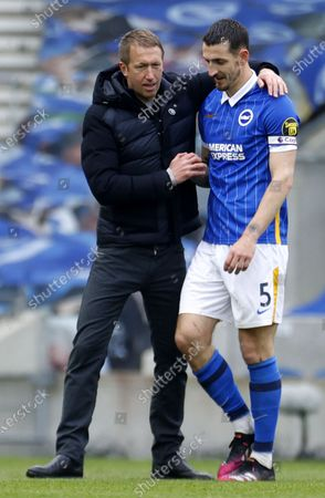 Brighton manager Graham Potter (L) celebrates with captain Lewis Dunk after winning the English Premier League soccer match between Brighton Hove Albion and Leeds United in Brighton, Britain, 01 May 2021.