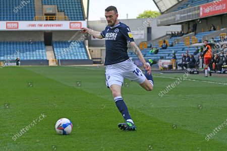 Millwall Defender Scott Malone(14)  crosses the ball  during the EFL Sky Bet Championship match between Millwall and Bristol City at The Den, London