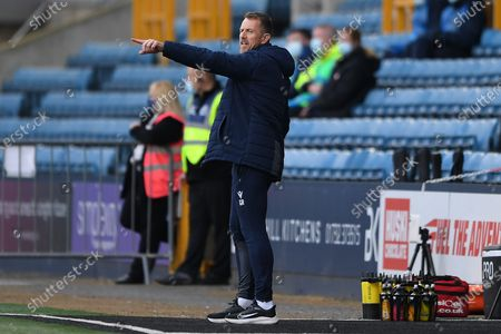 Stock Picture of Millwall Manager Gary Rowett  in the technical area pointing, directing, signalling, gesture during the EFL Sky Bet Championship match between Millwall and Bristol City at The Den, London