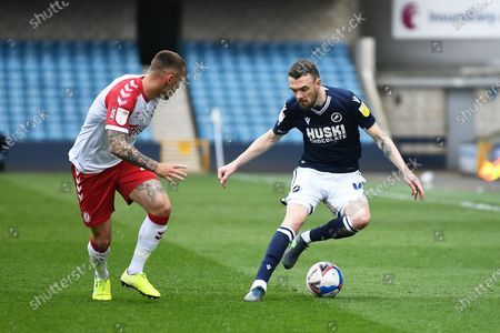 Millwall Defender Scott Malone(14)  takes on Bristol City Defender Jack Hunt (2)  during the EFL Sky Bet Championship match between Millwall and Bristol City at The Den, London