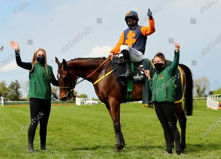 Stock Photo of The Ballymore Champion Four Year Old Hurdle . Sean Flanagan on Jeff Kidder with Emma Murray and Emma Connolly