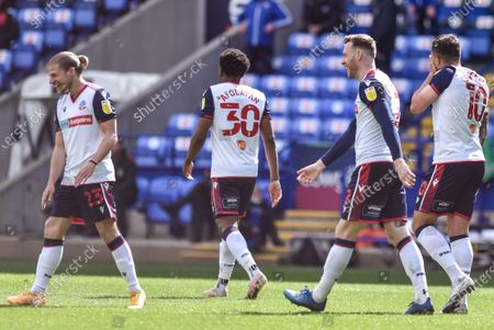 The Bolton team celebrate after Gethin Jones scores the opening goal of the match.