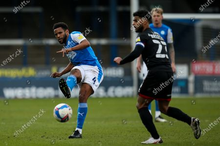 Nathan Thompson of Peterborough United passes the ball