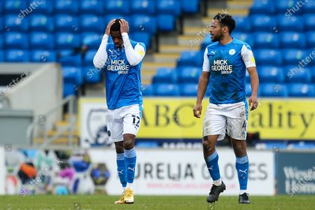 Reece Brown and Nathan Thompson of Peterborough United cuts a dejected figure