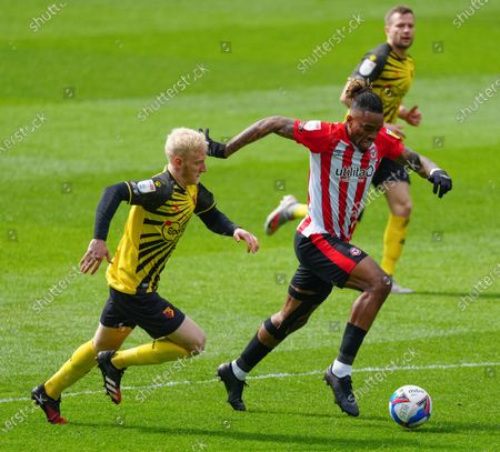 Ivan Toney of Brentford with Will Hughes of Watford