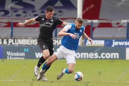 Stock Photo of Mark Beevers of Peterborough United in action with Tom Hopper of Lincoln City