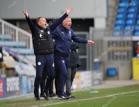 Darren Ferguson (Peterborough Utd manager) and his assistant Mark Robson, celebrate at the Peterborough United v Lincoln City EFL League One match at the Weston Homes Stadium, Peterborough, Cambridgeshire.