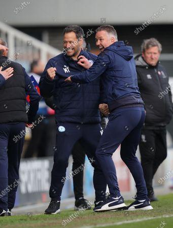 Stock Photo of Darren Ferguson (Peterborough Utd manager) celebrates with Mark Tyler as Posh gain promotion at the Peterborough United v Lincoln City EFL League One match at the Weston Homes Stadium, Peterborough, Cambridgeshire.