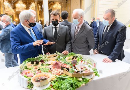 A guest, Emmanuel Macron, French Junior Minister of Small and Medium Enterprises Alain Griset and Guillaume Gomez