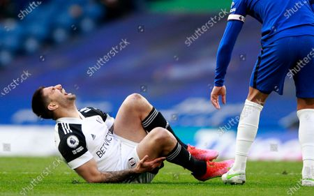 Fulham's Aleksandar Mitrovic reacts after sustaining an injury during the English Premier League soccer match between Chelsea and Fulham at Stamford Bridge Stadium in London