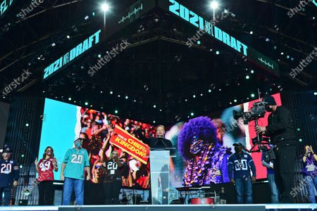 Commissioner Roger Goodell announces the start of the fourth round of the NFL football draft, in Cleveland