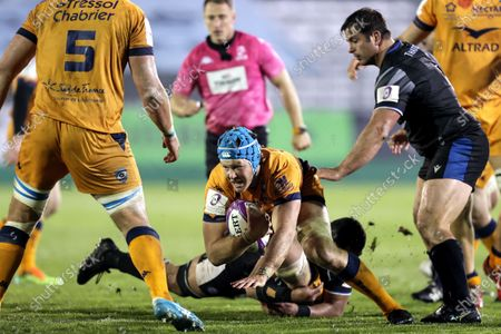 Bath Rugby vs Montpellier. Montpellier's Nicolaas Janse van Rensburg is tackled by Taulupe Faletau of Bath