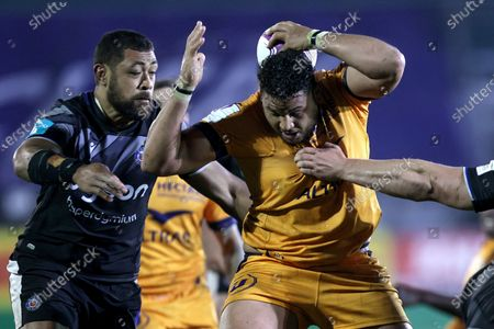 Stock Photo of Bath Rugby vs Montpellier. Montpellier's Mohamed Haouas and Taulupe Faletau of Bath