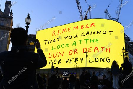 Stock Photo of People enjoy the David Hockney art installation