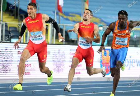 (L-R) Pol Retamal and Jose Gonzalez of Spain and Taymir Burnet of the Netherlands in action during the men's 4x100m relay heats of the World Athletics Relays Championships at the Silesian Stadium in Chorzow, southern Poland, 01 May 2021.